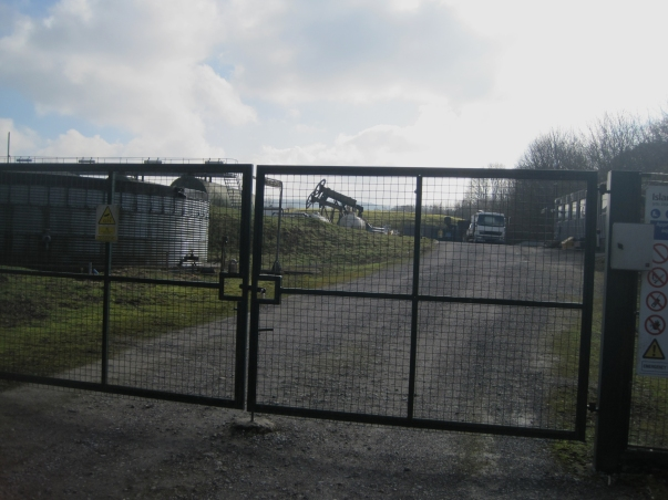 Compare and contrast: no sign of any razor wire on top of the gate or fences at this conventional drilling site at nearby Cootham
