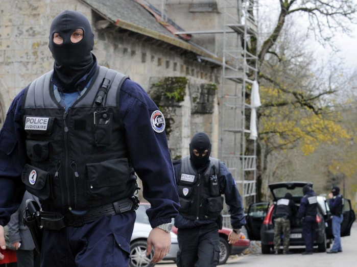 Police officers walk in the streets of the French city of Tarnac on November 11, 2008 where alleged anarchists have been arrested earlier. French police raided alleged anarchist cells in three cities today and arrested at least 10 suspects following a series of sabotage attacks on the country's high-speed rail network.  AFP PHOTO THIERRY ZOCCOLAN