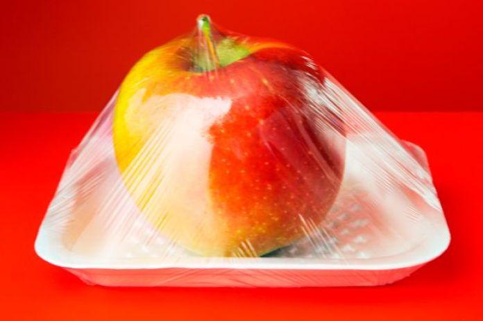 Apple in plastic