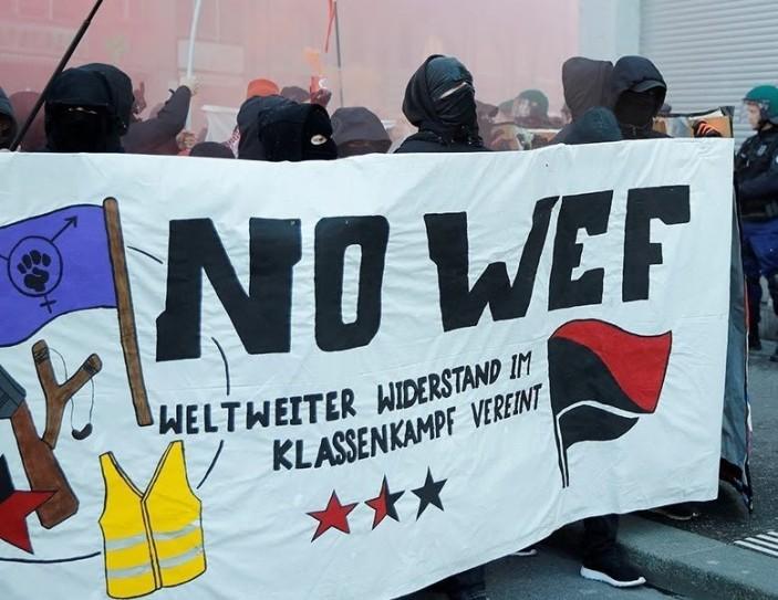 https://winteroakpress.files.wordpress.com/2020/10/wef-protest2.jpg?w=703&h=544